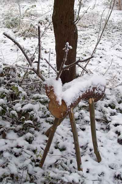 Wooden Reindeer Garden Ornament Covered In Snow